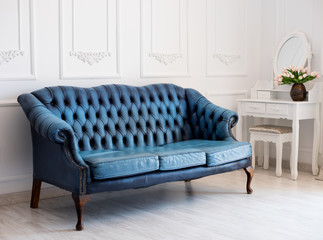 Luxurious leather blue sofa style vintage in the room