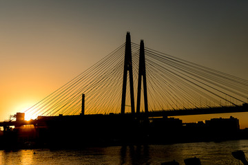Cable-stayed bridge on the Neva river in St. Petersburg in the sunset.