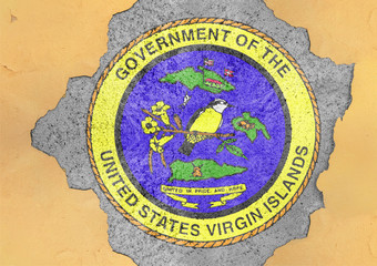 US state Virgin Islands seal flag painted on concrete hole and cracked wall facade structure