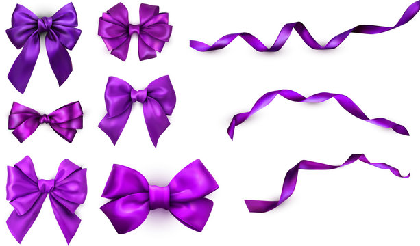 Purple realistic satin bows and ribbons isolated on white.