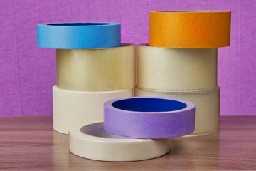 Set of transparent self adhesive tape and painting duct tape.