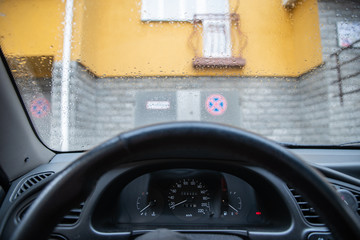 raindrops on car windshield close up
