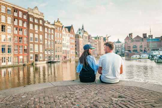 young couple at waterfront Amsterdam city trip Netherlands sunset summer