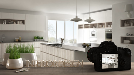 Architect photographer designer desktop concept, camera on wooden work desk with screen showing interior design project, blurred scene in the background, modern kitchen idea template