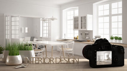Architect photographer designer desktop concept, camera on wooden work desk with screen showing interior design project, blurred scene in the background, scandinavian kitchen idea template