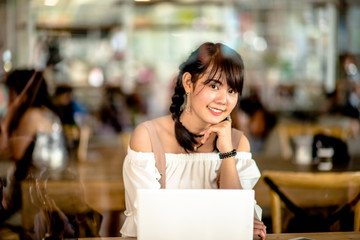 Asian young girl on tablet in internet cafe,select focus.