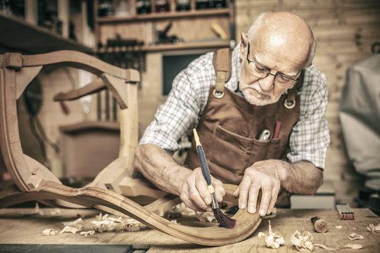 senior woodworker on duty