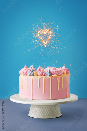 Birthday Cake Isolated On A Blue Background Party Decorated With Candles And Sparkles Copy Space