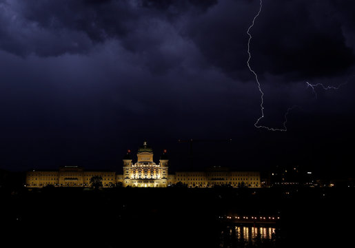 Lightning illuminates the sky above the Swiss Federal Palace in Bern