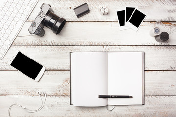 Open note book on photographer desk as minimal flat lay table top