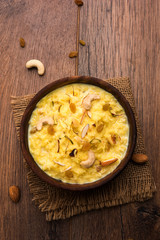Rice pudding OR Kheer from India called also called Firnee. served in a bowl. Selective focus