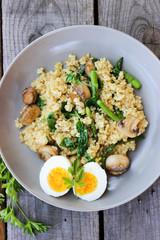 Warm bulgur salad with fried mushrooms, asparagus and spinach