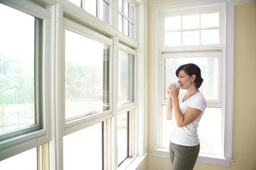 Woman Looking Out the Window. Wall mural