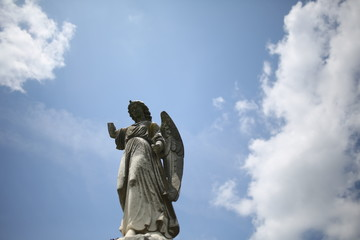 Christianity and Religious Iconography Angel Statue Figurine in a Graveyard