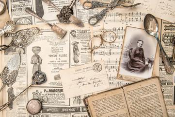 Antique books photos cutlery postcards news paper
