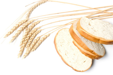 Slices of sliced bread and wheat on white background.