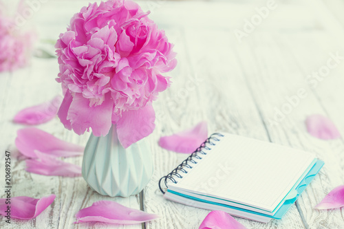 Beautiful Pale Pink Peonies Bouquet In Vase And Empty Notebook Over