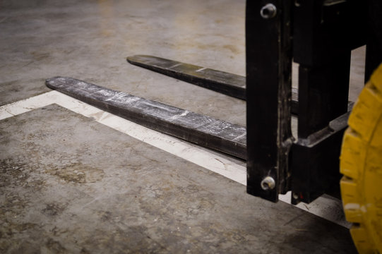 Forklift doing work in the warehouse on loading area background