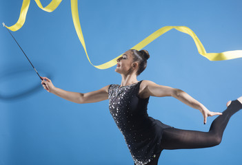Foto auf Leinwand Gymnastik Woman with ribbon for rhythmic gymnastic. Workout sports activities in gym of flexible girl. Sport success and health. Woman train acrobatics with ribbon. Fitness and dieting of girl gymnast.