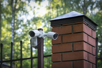 Street surveillance camera on the fence.