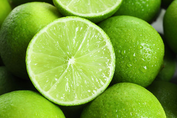 Fresh ripe green limes as background