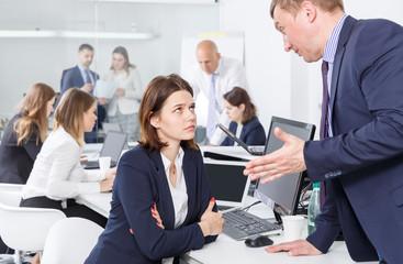 Ordinary boss scolding female subordinate