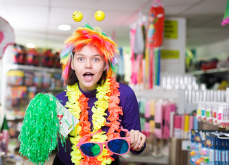 Female having fun in festival outfits store