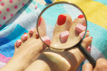 Woman magnifying pedicure