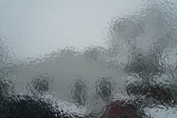 Surface of window after winter storm covered with sheet of ice