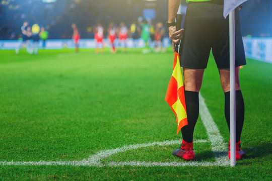 Lineman assistant referee at the corner of a soccer field.