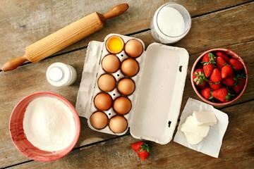 Set raw ingredients cooking strawberry pie cake wooden background Eggs flour milk sugar strawberry top view Bakery background Recipe strawberry pie