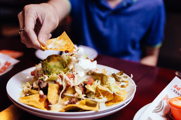 Hand pick Nacho salad with sliced cabbage, pickled chili, scoop of avocado and cheese dressing with thousand island.