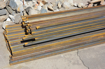 Steel channel at construction site. Pipe, Steel, and Farming Specials.