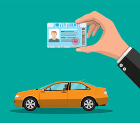 Driver license in hand and orange sedan car