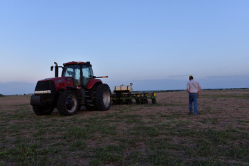 Cotton farmer Drew Malchoff arrives at sunrise in the field that he will be planting for the day near Wakita, Oklahoma,