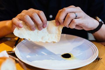 Italian Piadina tear by hands with balsamic in plate.