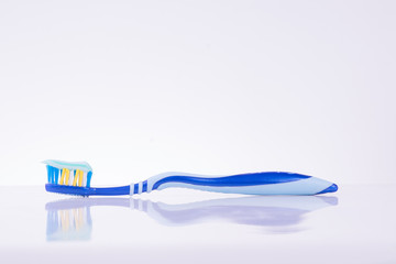 Toothbrush isolated over white background.