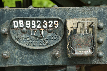 Broken number plate on railway wagon.