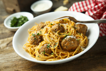 Spaghetti with meatballs and cheese