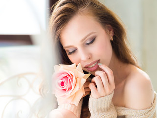 Beautiful girl with rose. Photo of happy brunette girl. Youth and skin care concept.