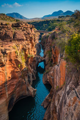 A portrait/vertical shot of the gorge at Bourke's Luck Potholes in Mpumalanga, South Africa; a geological formation carved out by the movement of water