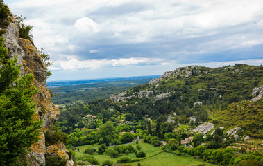 Picturesque view on valley and mountains from  Les Baux-de-Provence village in Provence, France.