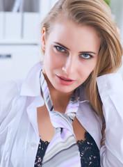 Fototapeta Sexy secretary in glasses undresses in office, flirt and desire. Office provocation. obraz