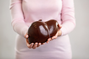 Study material. Human liver model being in professional teachers hands while showing it to you