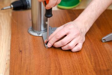 Image of man picking furniture