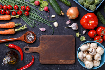 Picture on top of fresh vegetables, champignons, cutting board, butter