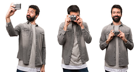 Set of Handsome man with beard photographing
