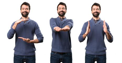 Set of Handsome brunette man with beard holding something