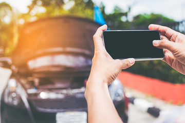 Closeup shot of man using smartphone with isolated screen after car accident