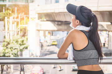 Woman is exercising in the city